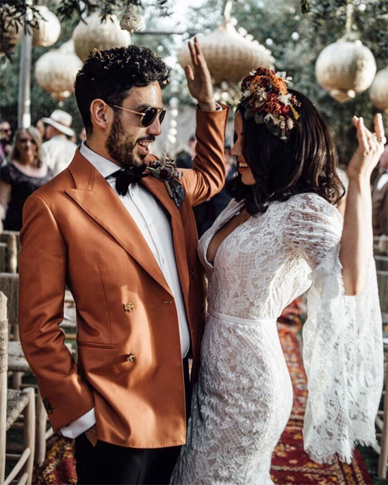 Rust Boho wedding - groom looked very smart indeed in a rust suit and black tie  completed with boho style boutonniere