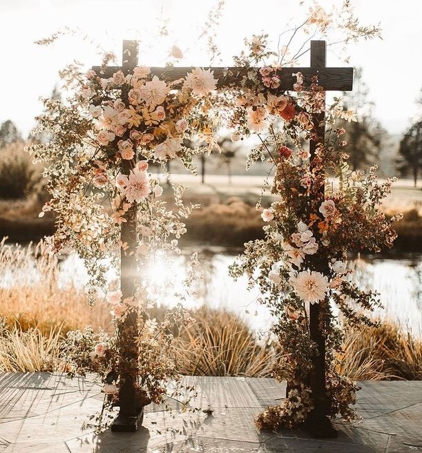 7 Wedding Arches That Will Instantly Upgrade Your Ceremony - fall flowers decorated wedding arch - Fall wedding ideas #fallwedding #autumnwedding