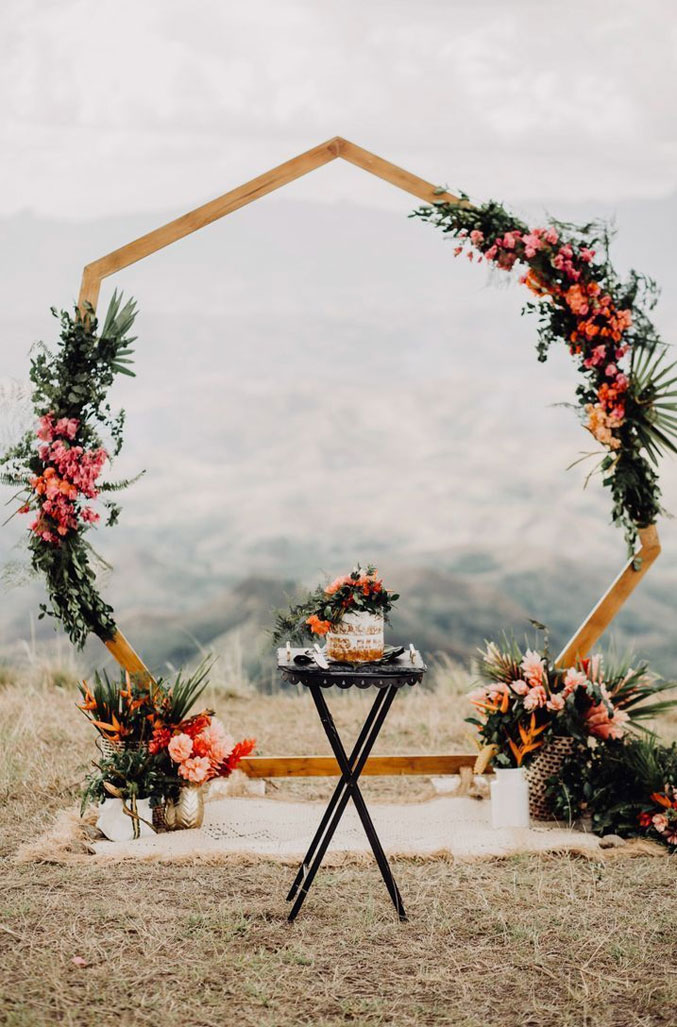 7 Wedding Arches That Will Instantly Upgrade Your Ceremony - Hexagon wedding arch with fall wedding flowers - geometric wedding ideas - Fall wedding ideas #fallwedding #autumnwedding