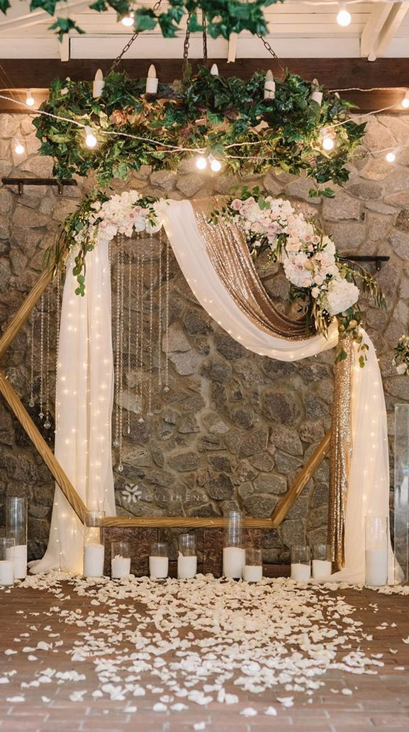 7 Wedding Arches That Will Instantly Upgrade Your Ceremony - Hexagon wedding arch with neutral flower - geometric wedding ideas #weddingarch #geometricwedding