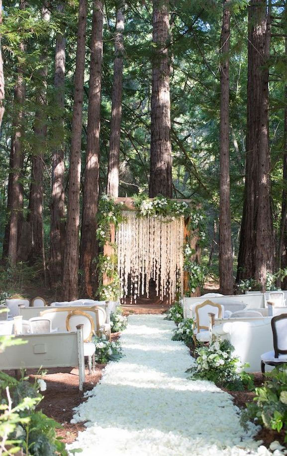 7 Wedding Arches That Will Instantly Upgrade Your Ceremony - Enchanted forest wedding decorations #weddingarch #weddingdecor