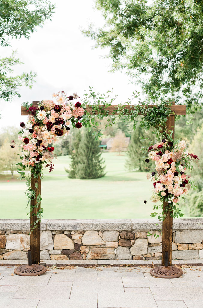 7 Wedding Arches That Will Instantly Upgrade Your Ceremony - Beautiful Dahlia wedding arch - Blush and burgundy flower wedding arch #fallwedding