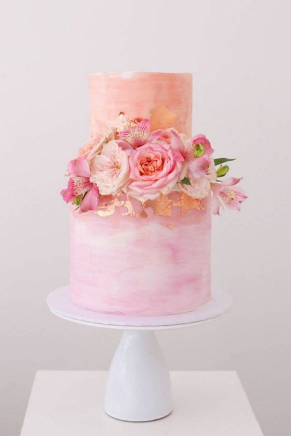 ombre pink watercolor + gold foil and pink blooms - The prettiest floral wedding cakes for any season #weddingcake