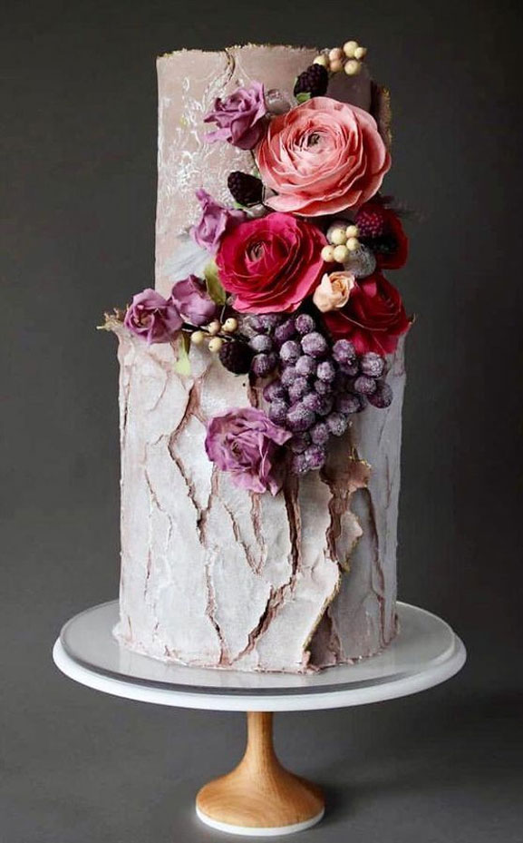 The prettiest floral wedding cakes for any season - two-tired wedding cake decorated with amazing seasonal fruits #weddingcake