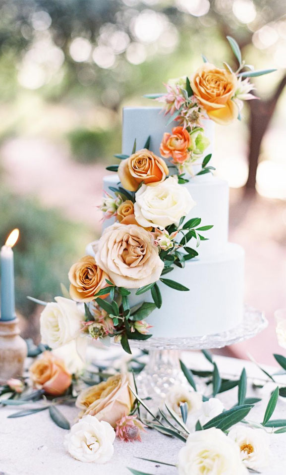 Chic, clean and pretty wedding cake with pretty peach colour floral touches
