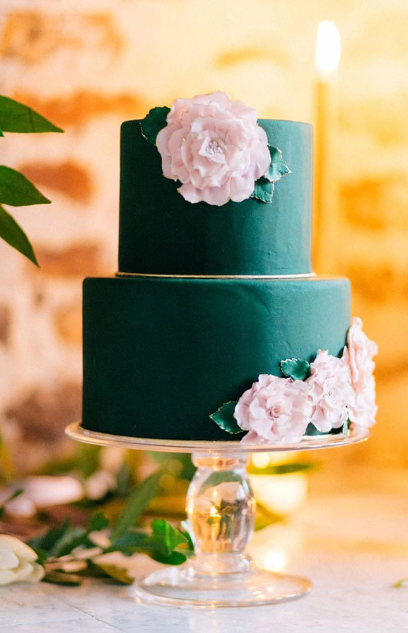 Green emerald wedding cake with pink sugar flowers