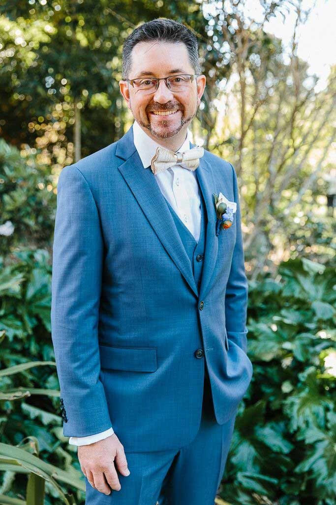 blue groom suit, groom wear blue and ivory bow tie