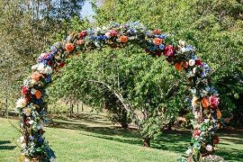 wedding arch, diy wedding arches, wedding arch flowers, wedding arch ideas, circular wedding arch, colorful wedding arch, wedding archway with silk flowers