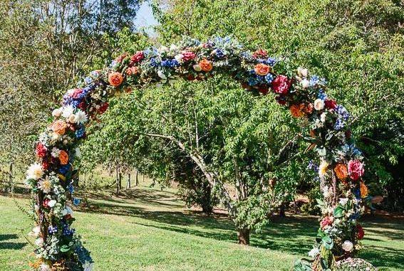 wedding arch, diy wedding arches, wedding arch flowers, wedding arch ideas, circular wedding arch, colorful wedding arch, wedding archway with silk flowers