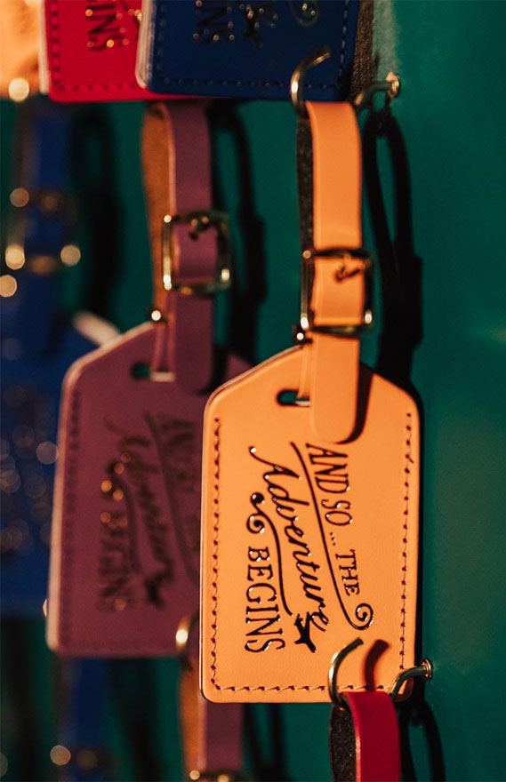 The cutest little luggage tags as escort cards & favors!