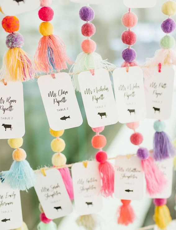 pom pom wedding escort cards, pom pom escort cards, fun escort card ideas, colorful escort cards, fun escort card displays