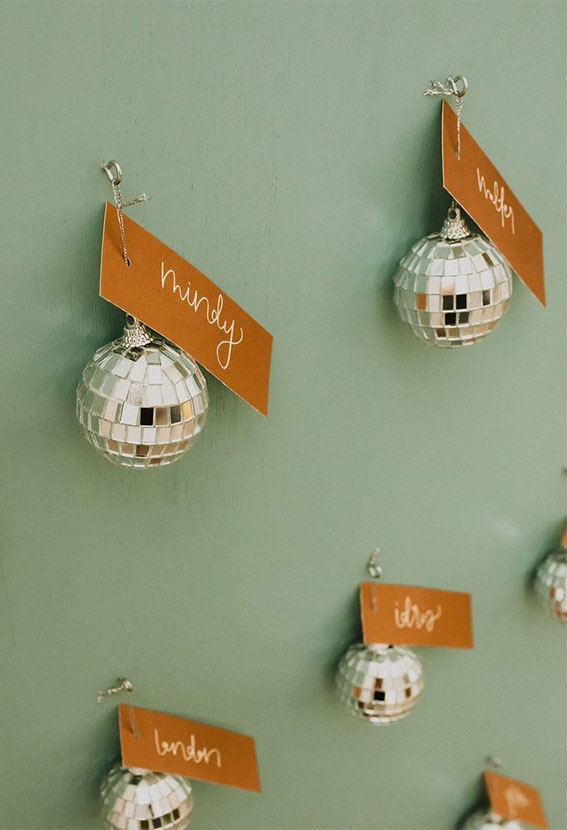 Disco ball wedding escort cards and favors