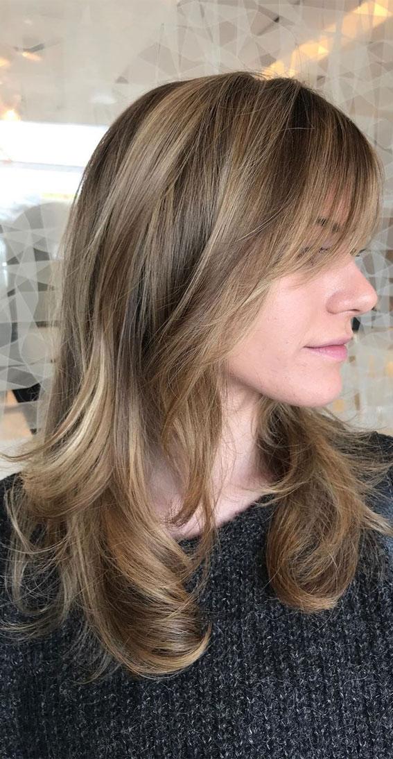 layered haircut with bangs, curtain bangs