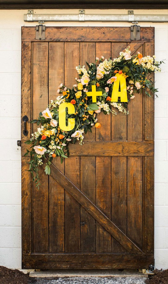 citrus wedding decor, colorful garland