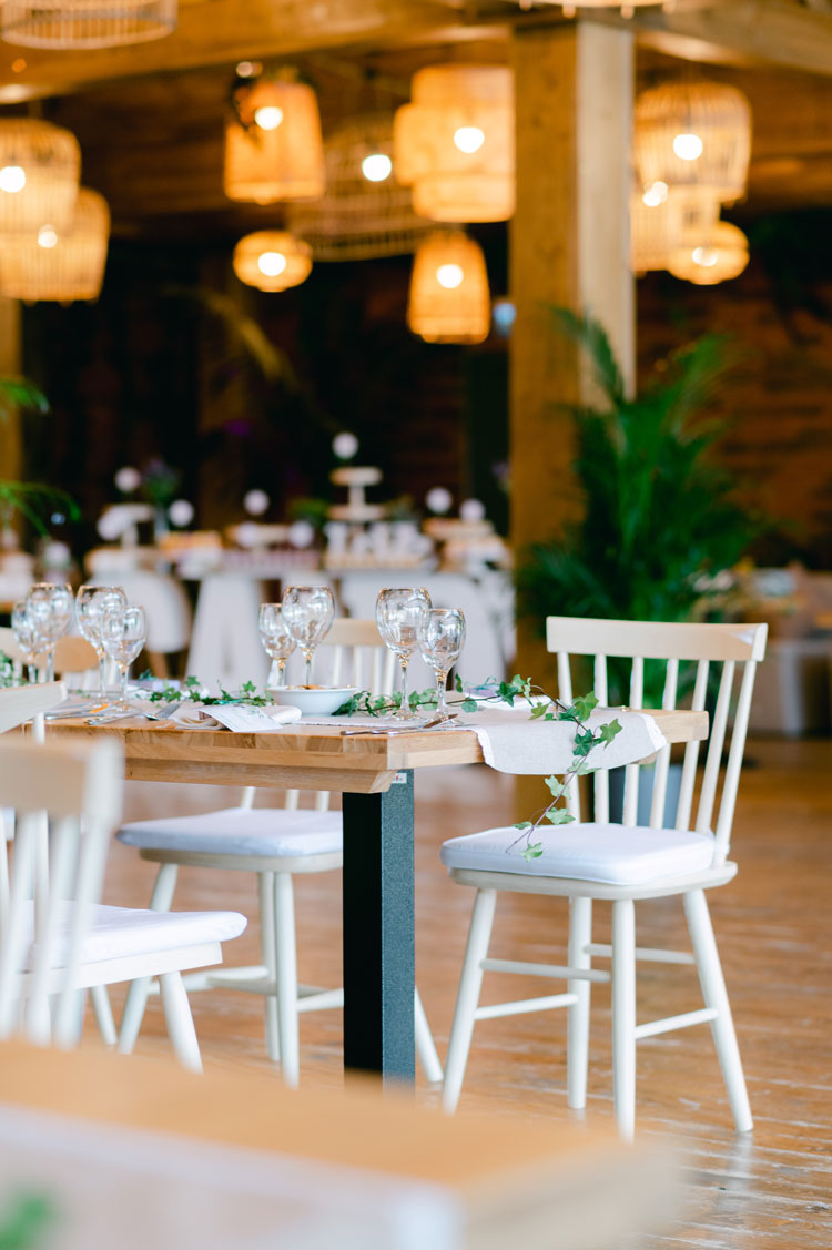 green and white wedding theme, wedding reception decorations, wicker lantern hanging from the ceiling