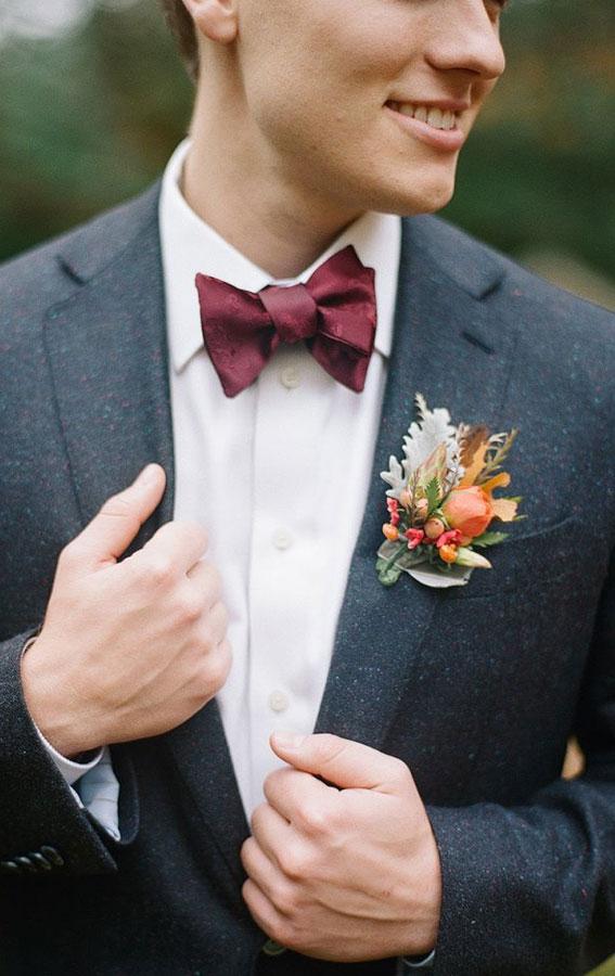 groom navy suit, burgundy bow tie, burgundy and navy wedding
