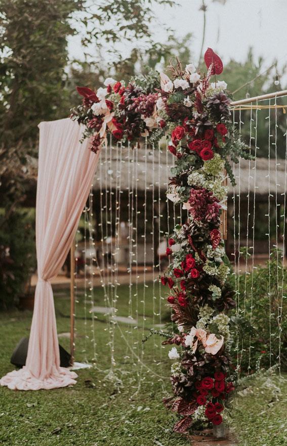 deep red and peach wedding, fall wedding ceremony, autumn wedding ceremony decor, autumn wedding arch, fall wedding aisle