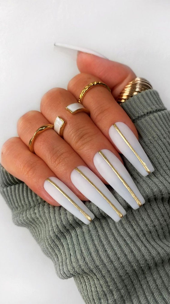 long coffin white nails with gold line, white nail polish, white nail art, white nails, white nail designs, white nail designs 2021, white nail designs coffin, white nail designs acrylic, white nail art, white nail ideas, white acrylic nails, simple white nail designs