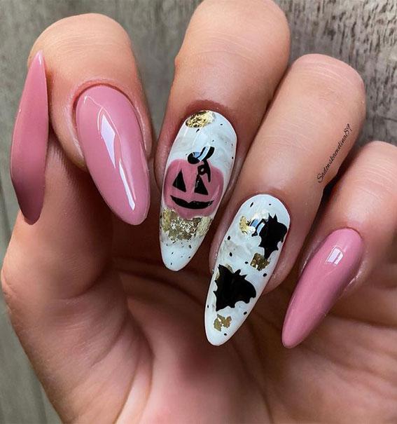 pumpkin face halloween nails, pumpkin face nails, best halloween nails 2021, cute halloween nails